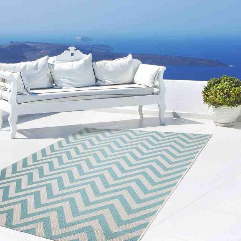 tappeto moderno geometrico equator 360 turchese-avorio
